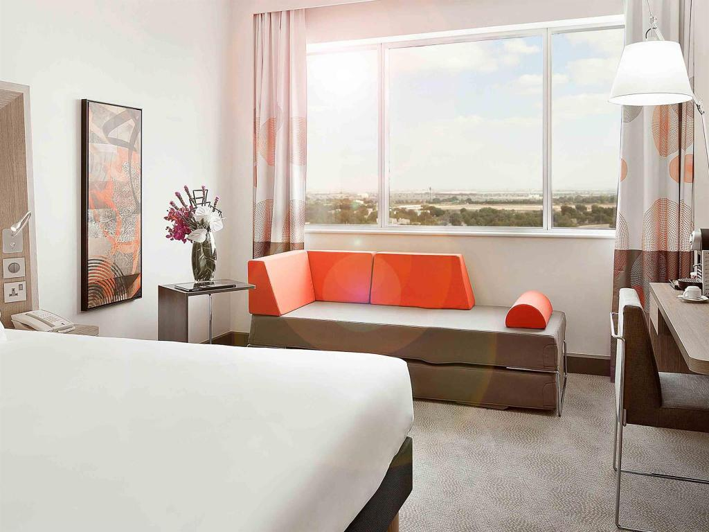 Executive Room with Double Bed and Sofa - View Novotel World Trade Centre Hotel