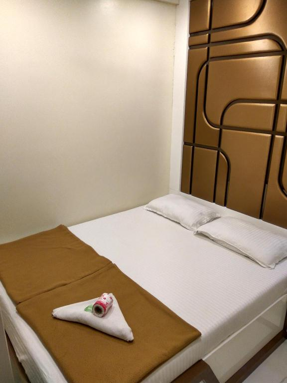 Kamar Deluxe Single - Ranjang Hotel Broadway Colaba