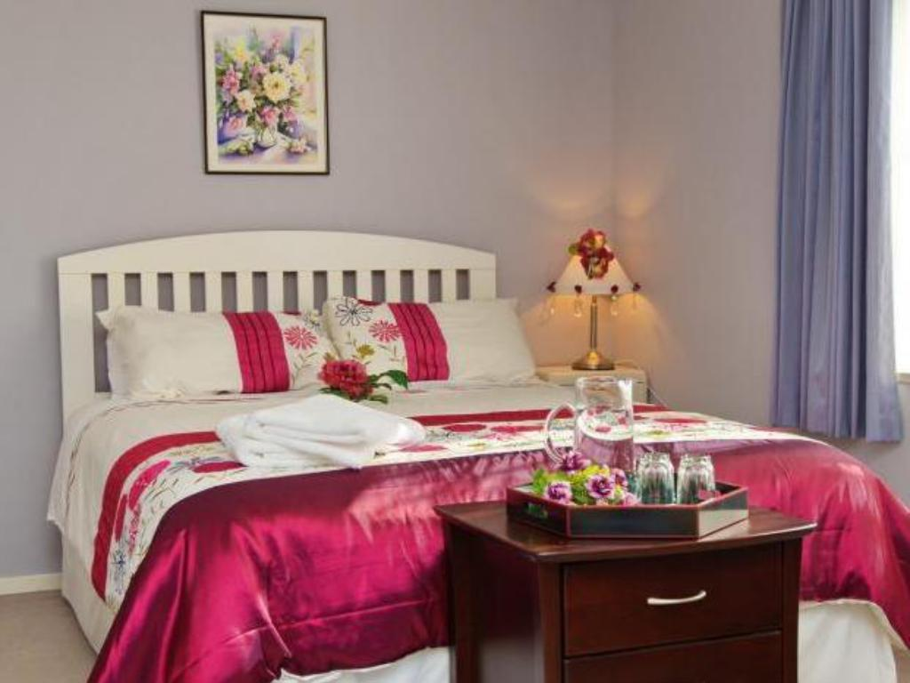Kamar Queen Magnolia Rose Bed and Breakfast