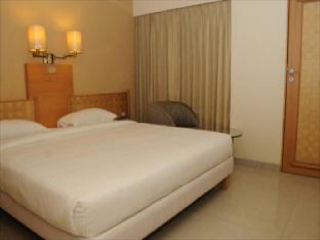 Deluxe Room - Bed Hotel Orchard