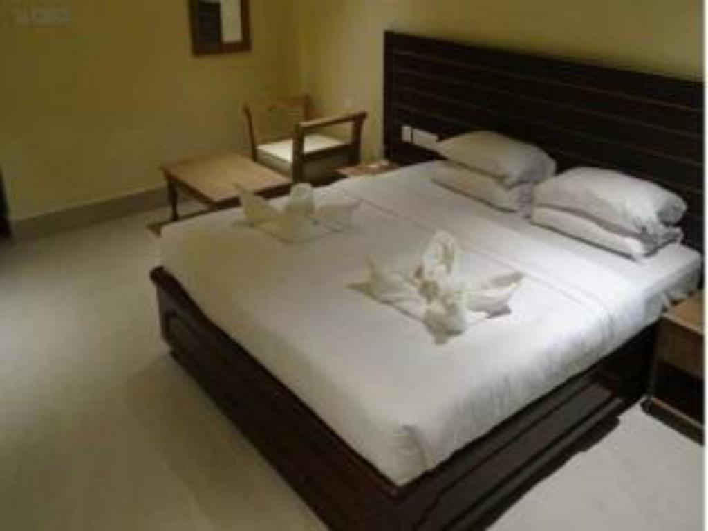 Double Room - Bed Toshali Pushpagiri Resort