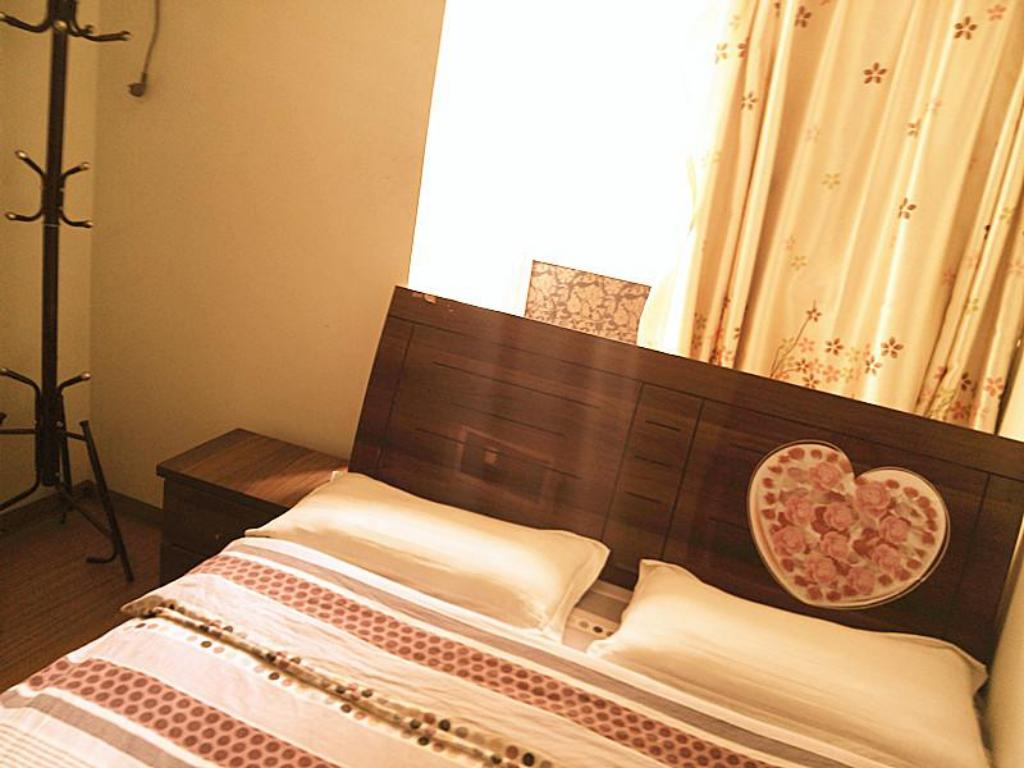 Интерьер Xian Guohua Apartment Hotel