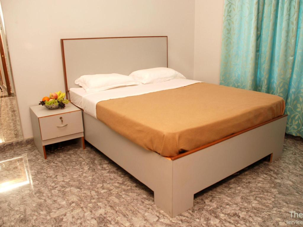 Budget Room - Non AC - Κρεβάτι The Kaiser International - Serviced Apartments