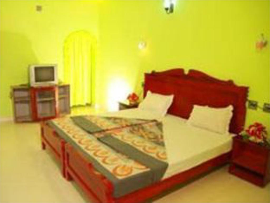 Deluxe Double Room - Bed Rainbow Cottage