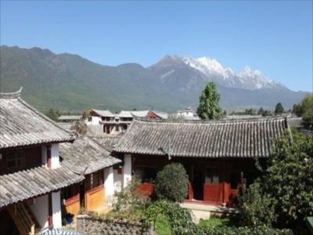 Hotelli välisilme Lijiang Baisha There International Youth Hostel