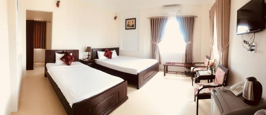 Twin Room - 2 Single Beds - Guestroom Nam Long Plus Hotel