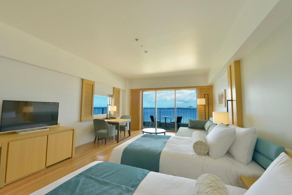 Deluxe Ocean View Twin Bed Room - Bed Hotel Orion Motobu Resort and Spa