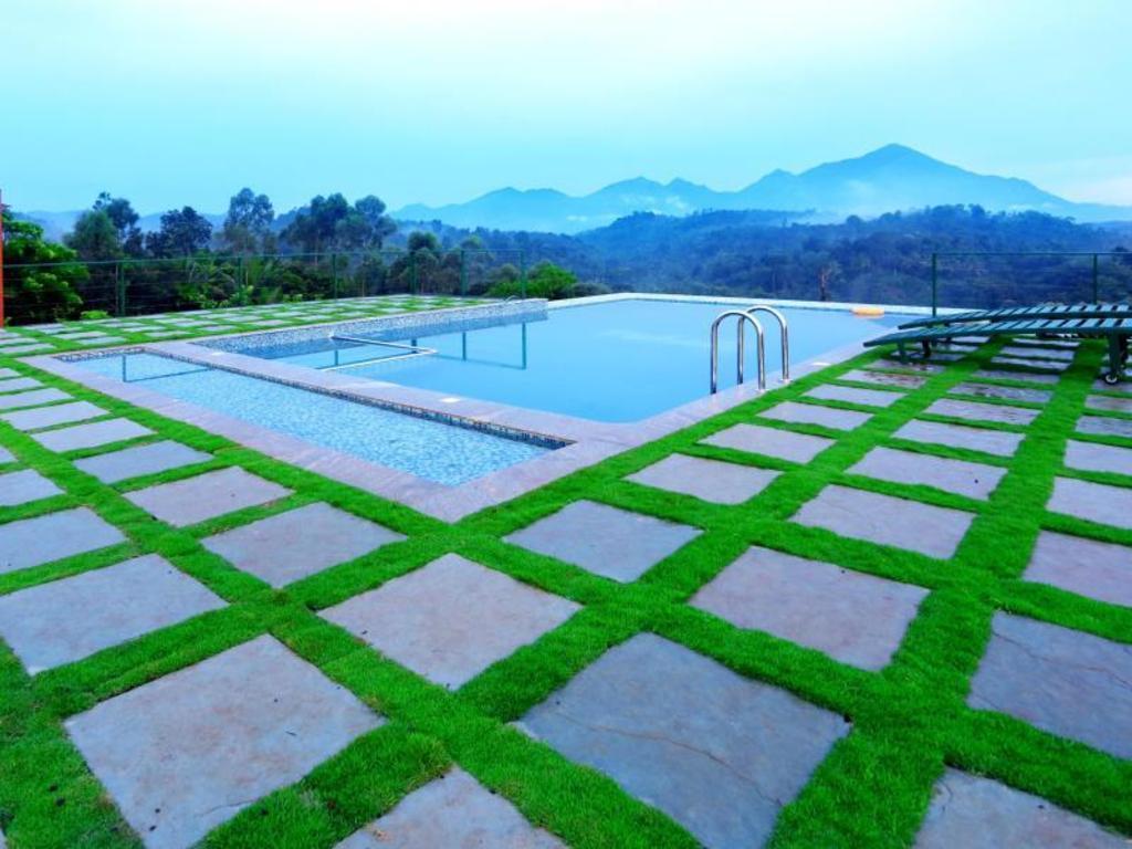 Petals resort in wayanad room deals photos reviews for Resorts in wayanad with swimming pool