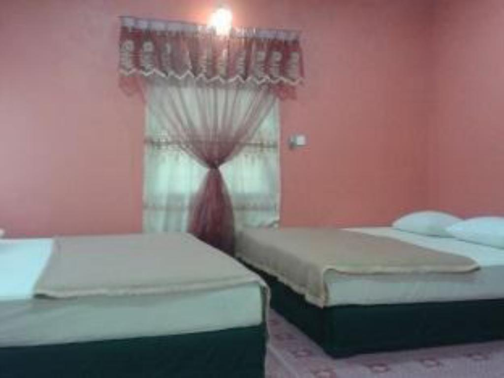 Quarto Familiar (4 Adultos) Nur Airport Guesthouse Langkawi