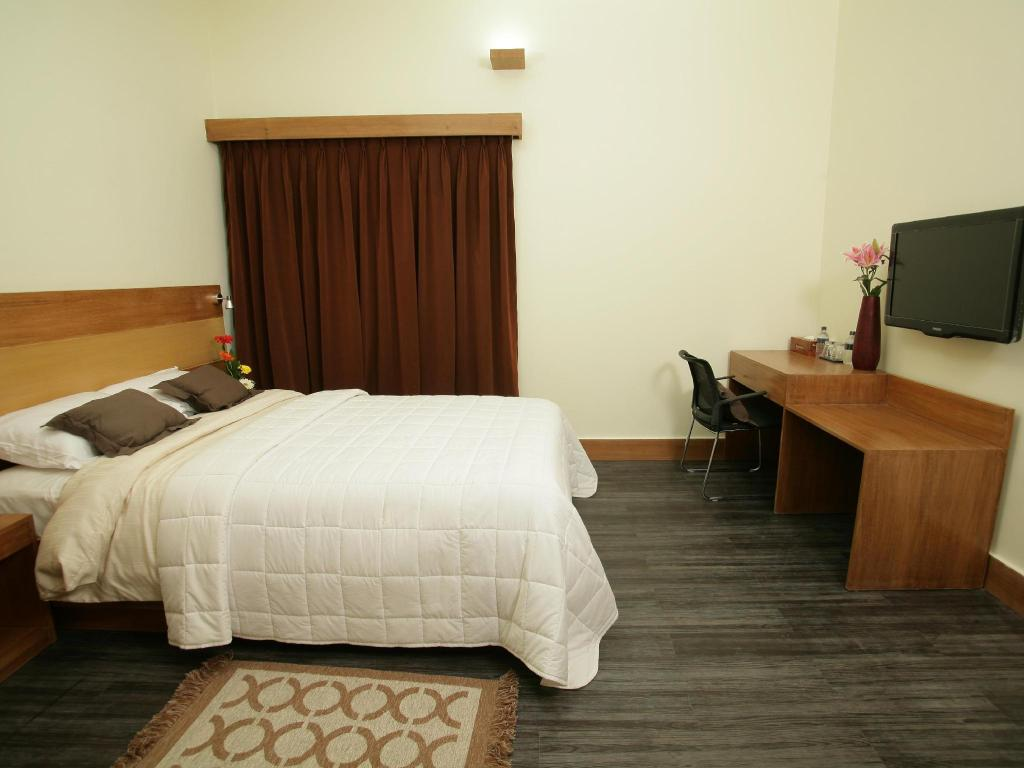 Single Deluxe Room - Guestroom Richmond Hotel and Suites