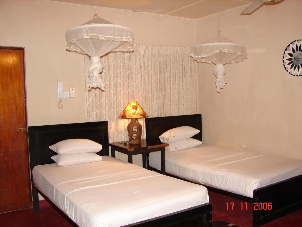 Standard - 1 Double - Guestroom Safari Village Hotel