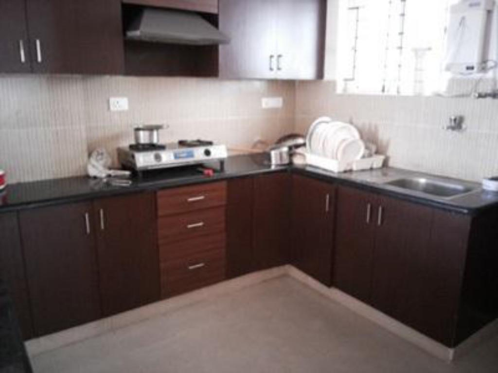 kitchen Nandu Hospitality Whitefield Guest House