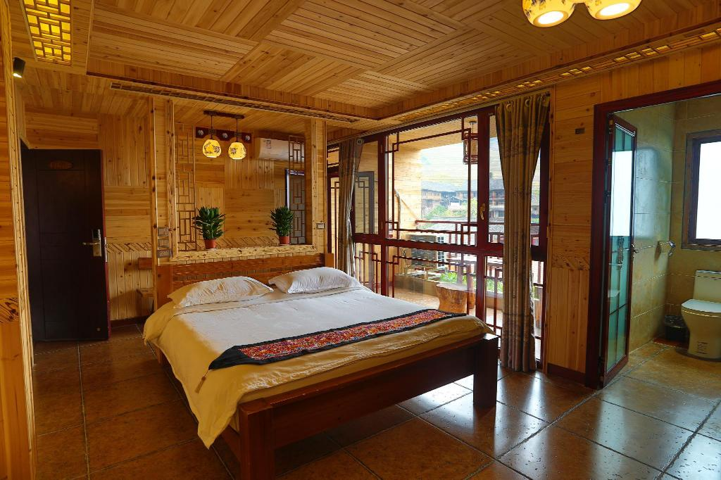 Deluxe King Bed - Room plan Longsheng Longji Holiday Hotel