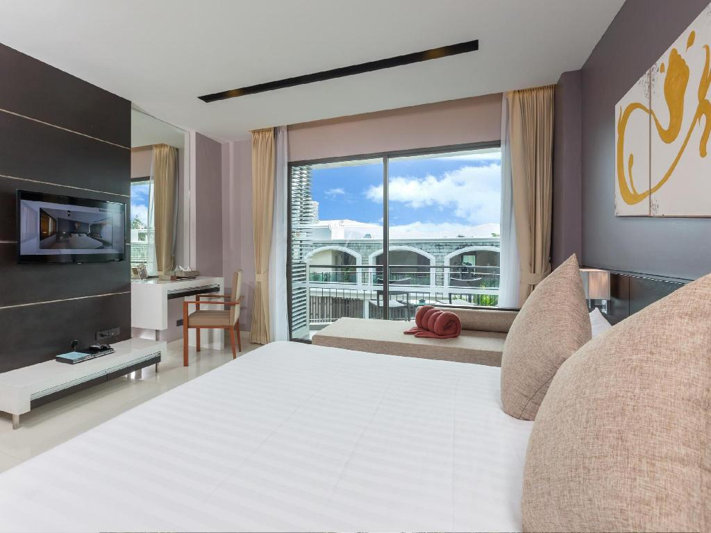 Deluxe Room The Charm Resort Phuket SHA Certified