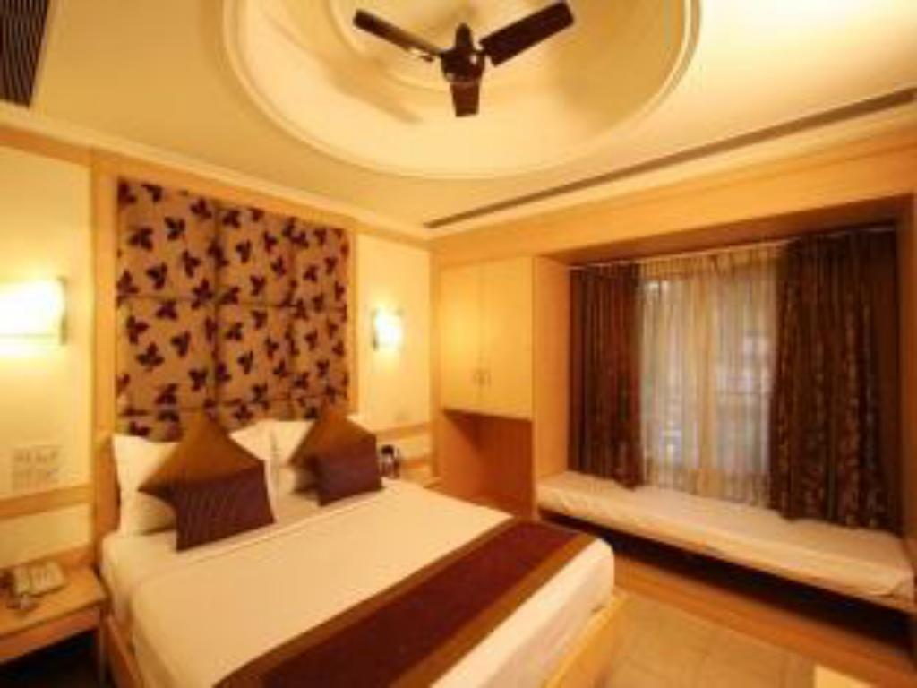 Deluxe Room - Bed Hotel Southern Regency