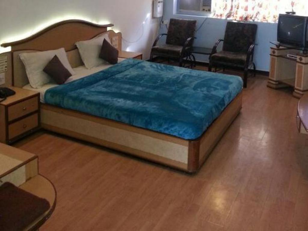 Standard Non AC Room - Bed Hotel JMC Group
