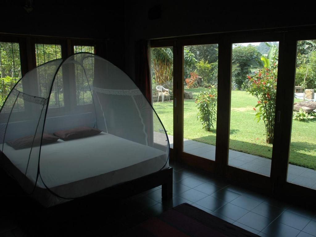 Standard Room - Bed Tranquility - The Hide-Out Hotel