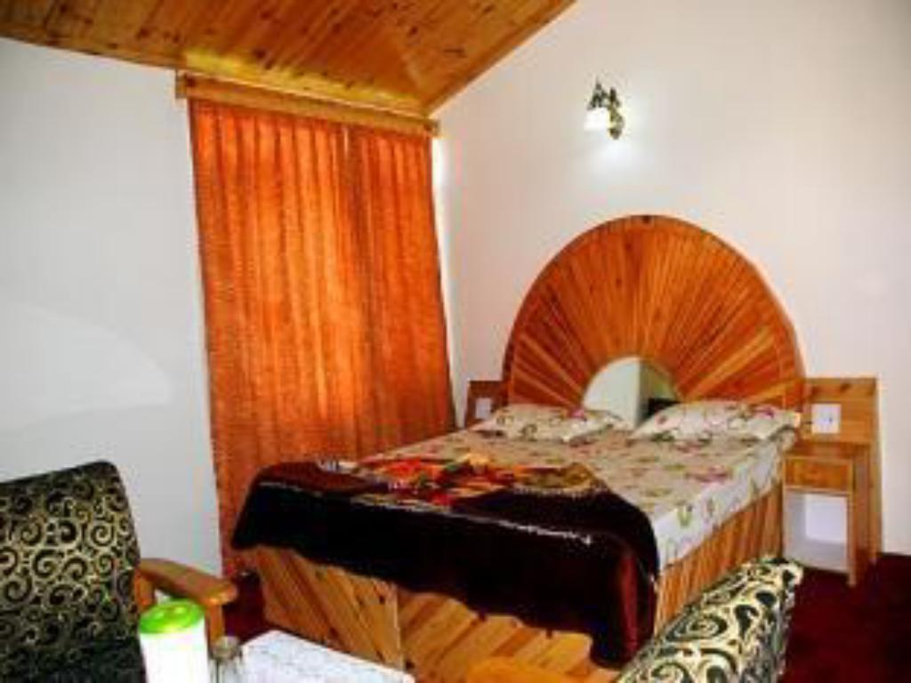Super Deluxe - Bed Red Rose Cottages Manali