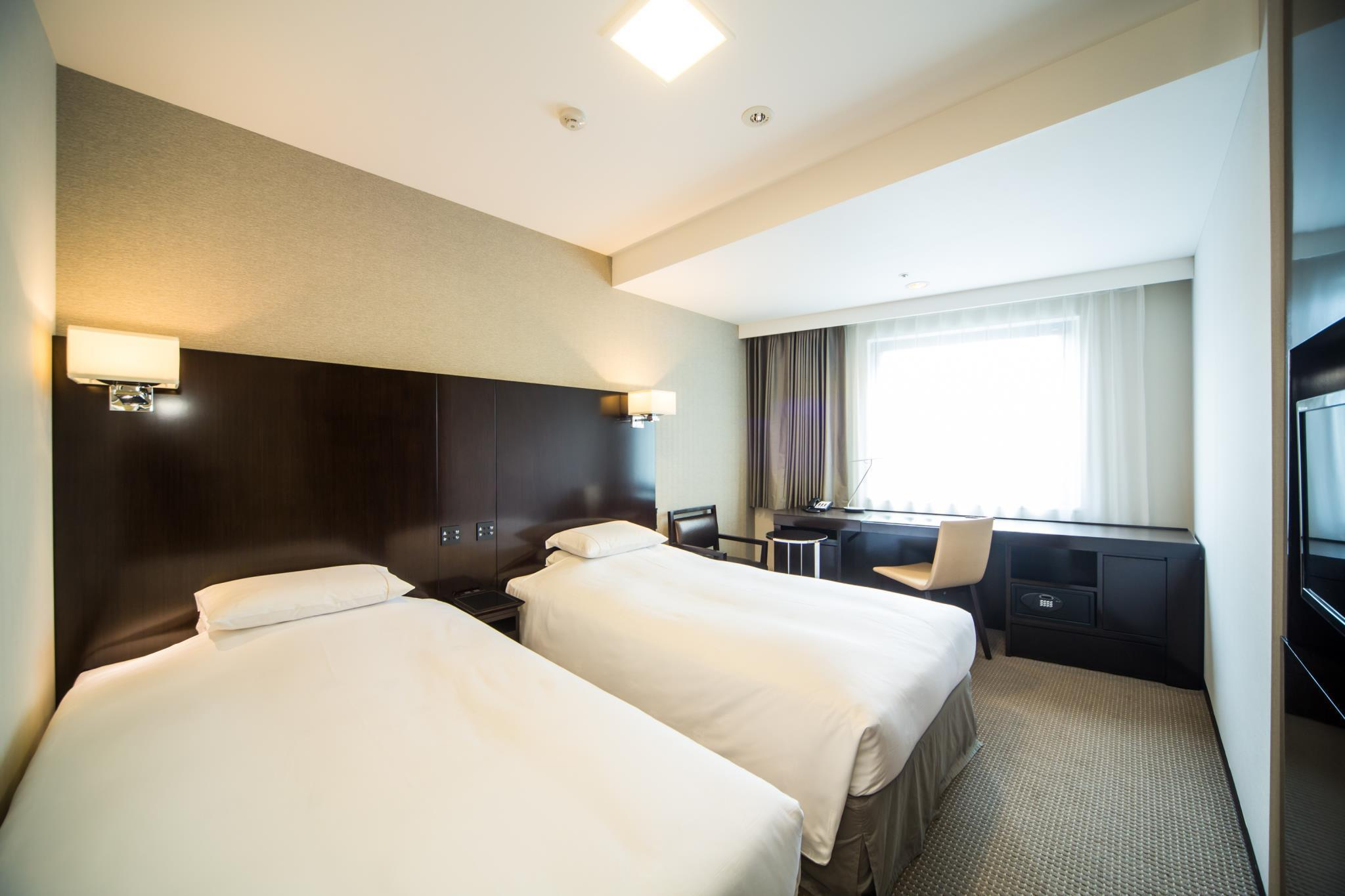 Kahden hengen-huone ‒ 1 hengelle, savuton (Twin Room for 1 Person - Non-Smoking)