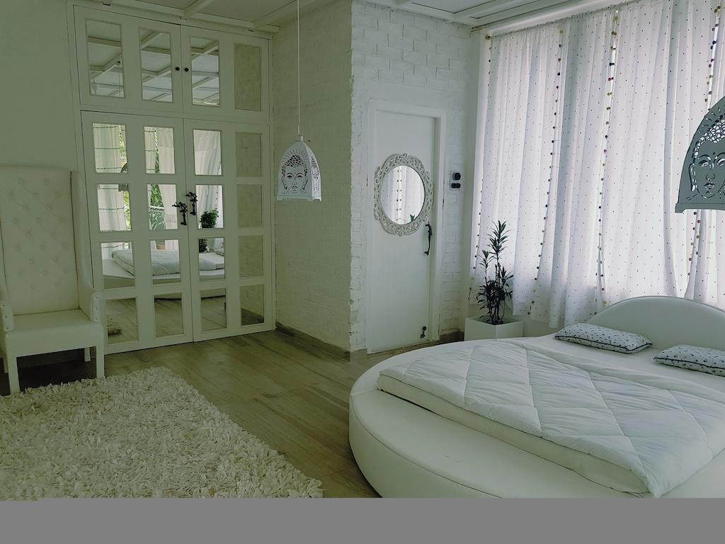 Best Price on Homestay by the Tea Garden (The White Room) in