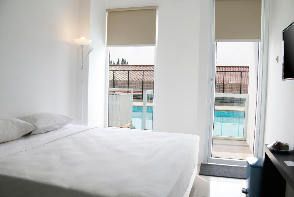 Superior City View - Bed Indoluxe Rent Apartment Jogja