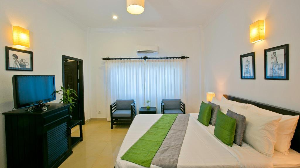 Deluxe Double or Twin Room - Bed The Cyclo d'Angkor Boutique Hotel