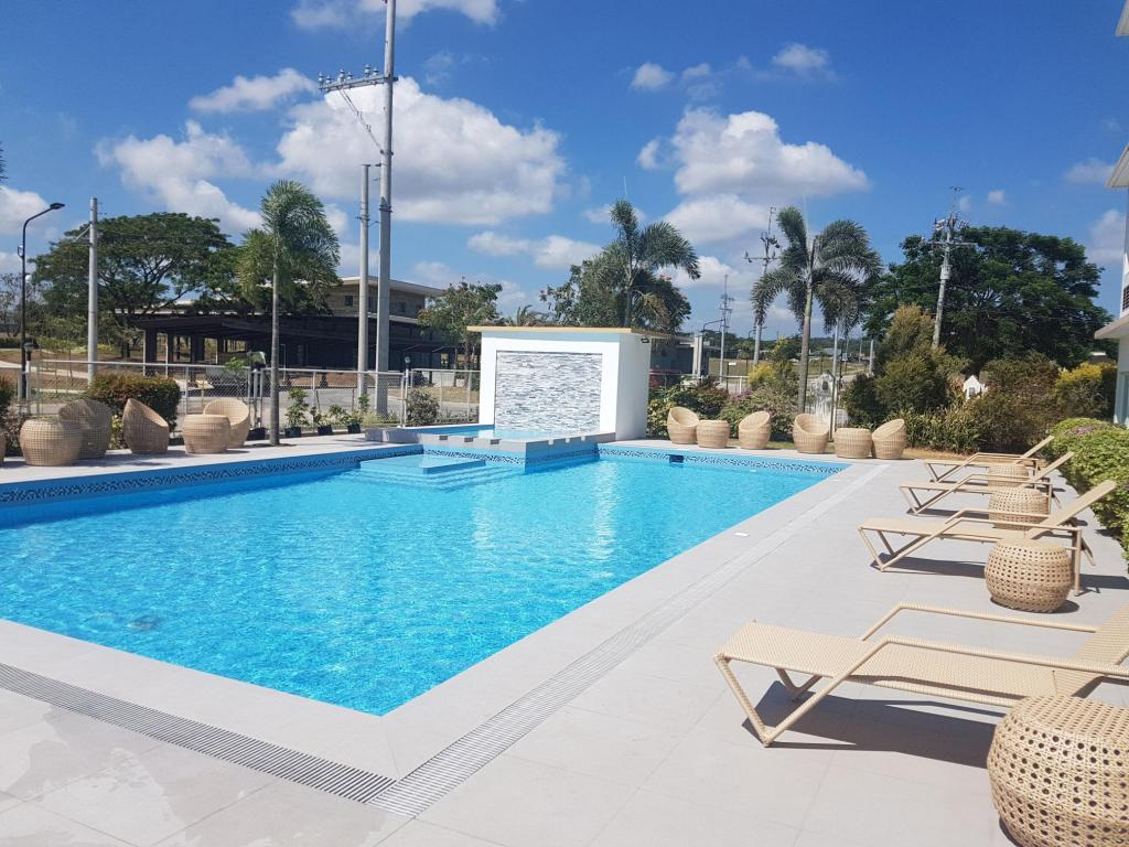 Microtel by wyndham south forbes nuvali sta rosa in - Beach with swimming pool in cavite ...