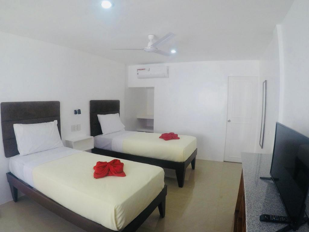 Deluxe Twin - Bedroom Heartland Hotel Serviced Rooms & Apartments