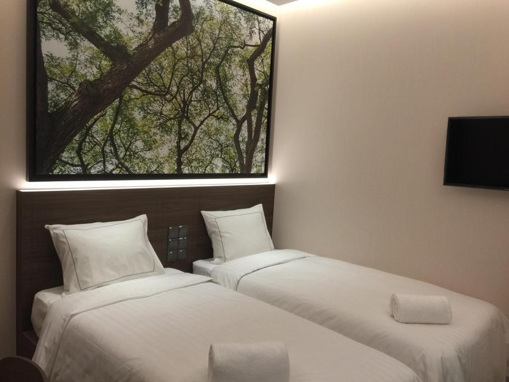 Standard Twin Bed Without Window Populous Hotel @ Bugis
