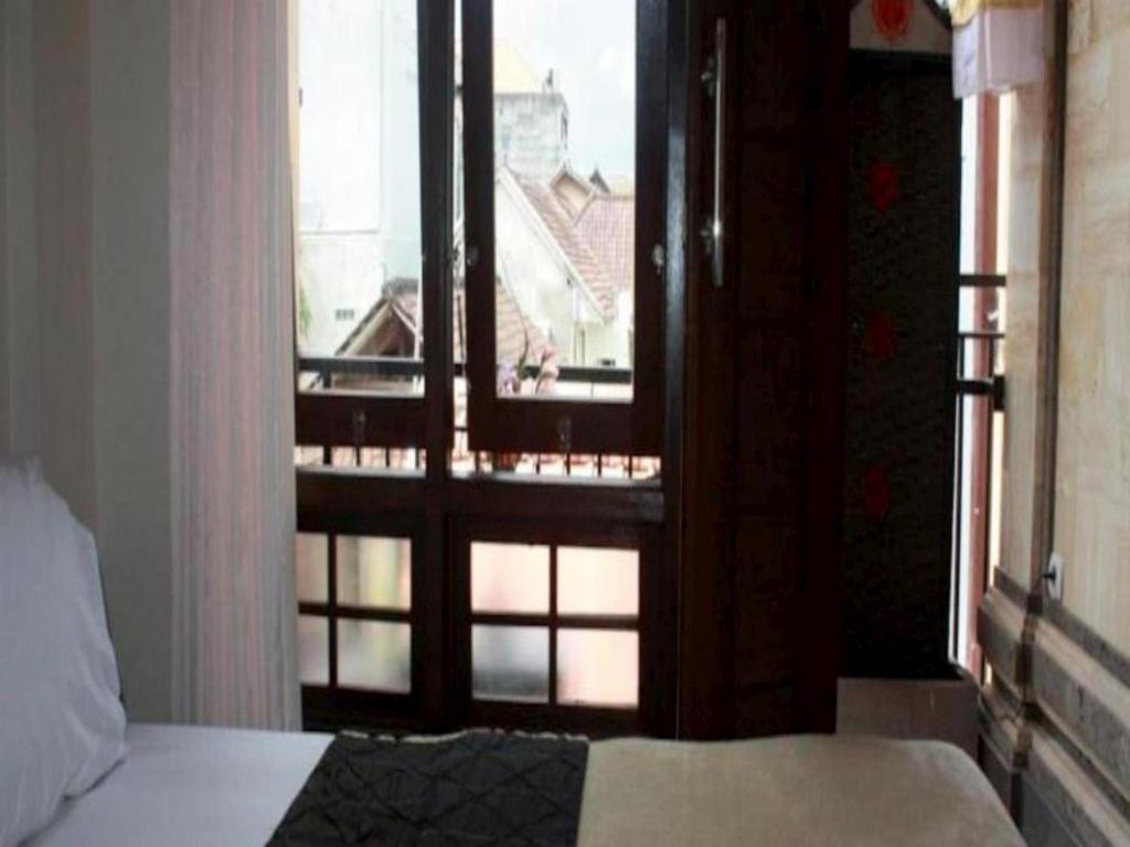 Deluxe Double Room - Bed Corner Guest House Ubud