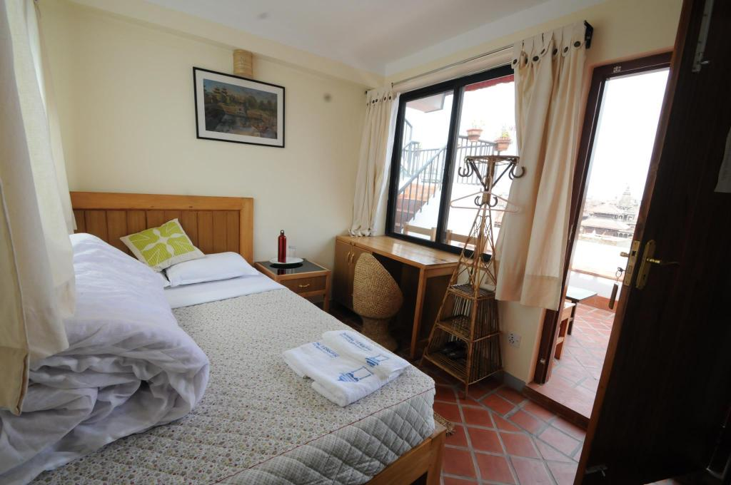 Double Room with Balcony - Bed Lalit Heritage Home