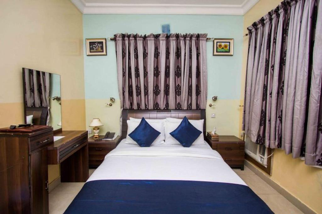 Kamar Standard - Ranjang Erith Apartments and Suites