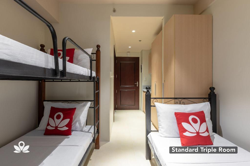 Standard Triple Room - Bedroom ZEN Rooms Marvelle Studios BGC