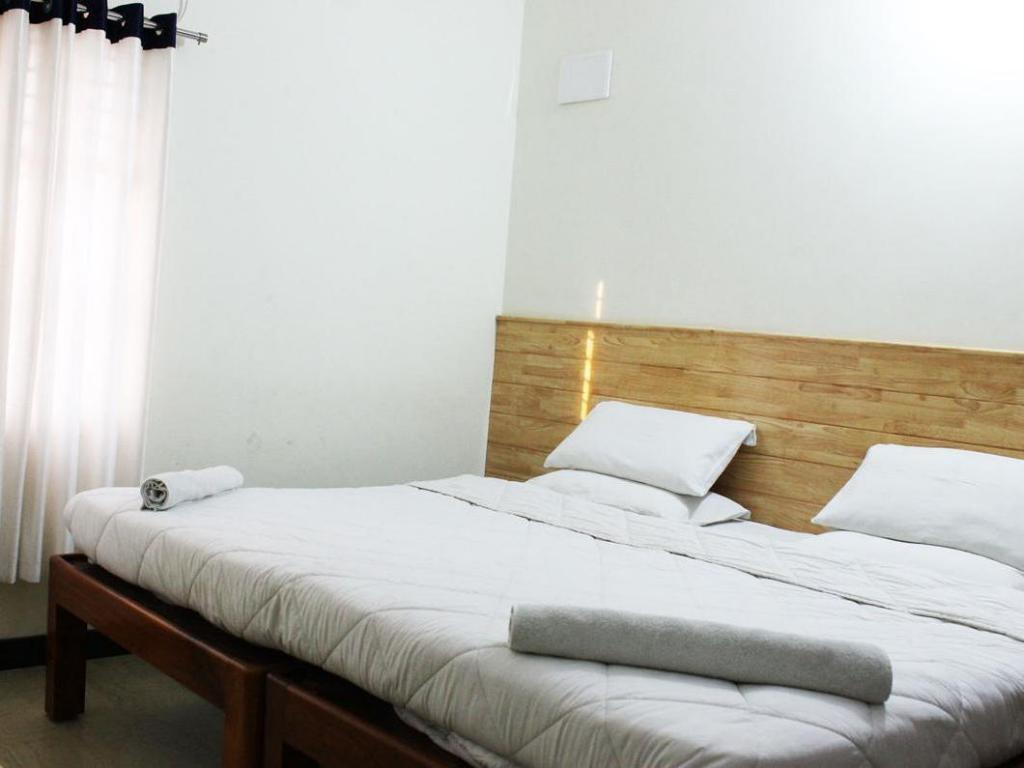 Deluxe Air Conditioning - Bed Hotel Olive Residency