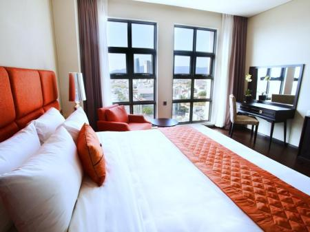 Deluxe Double - 1 King Bed - Bed Sanouva Danang Hotel