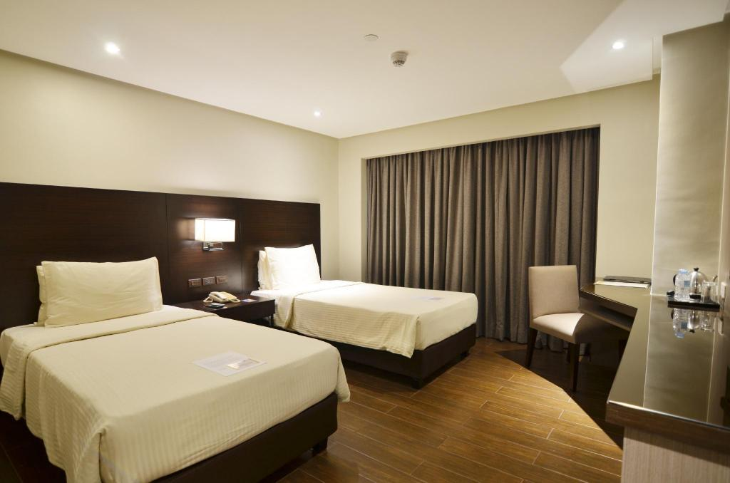 Deluxe Twin Bed - Bed Pearl Garden Hotel
