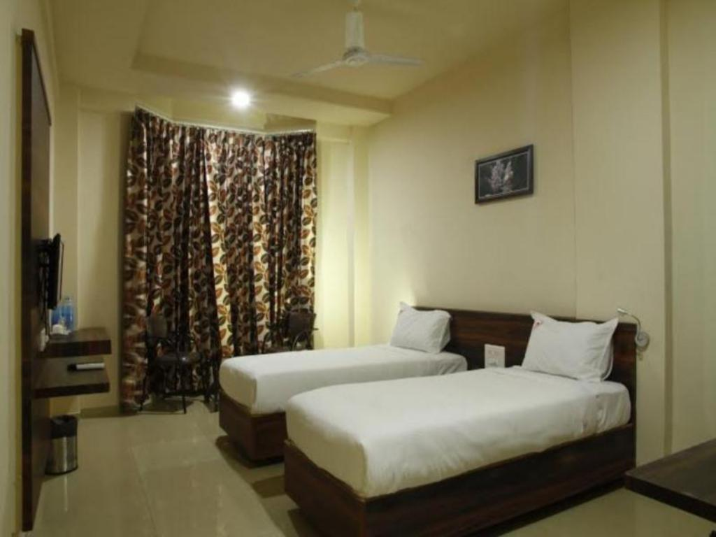Supreme Room Hotel Sangam Regency