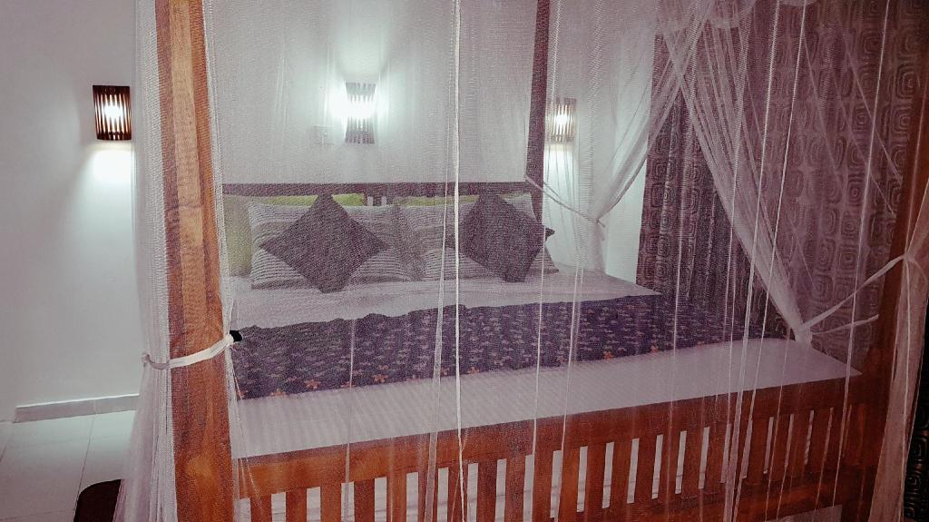 Deluxe Triple Room - Bed