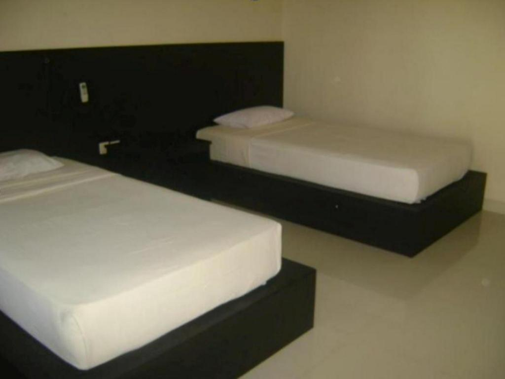 Standard With Fan - Bed Kuta Indah Hotel
