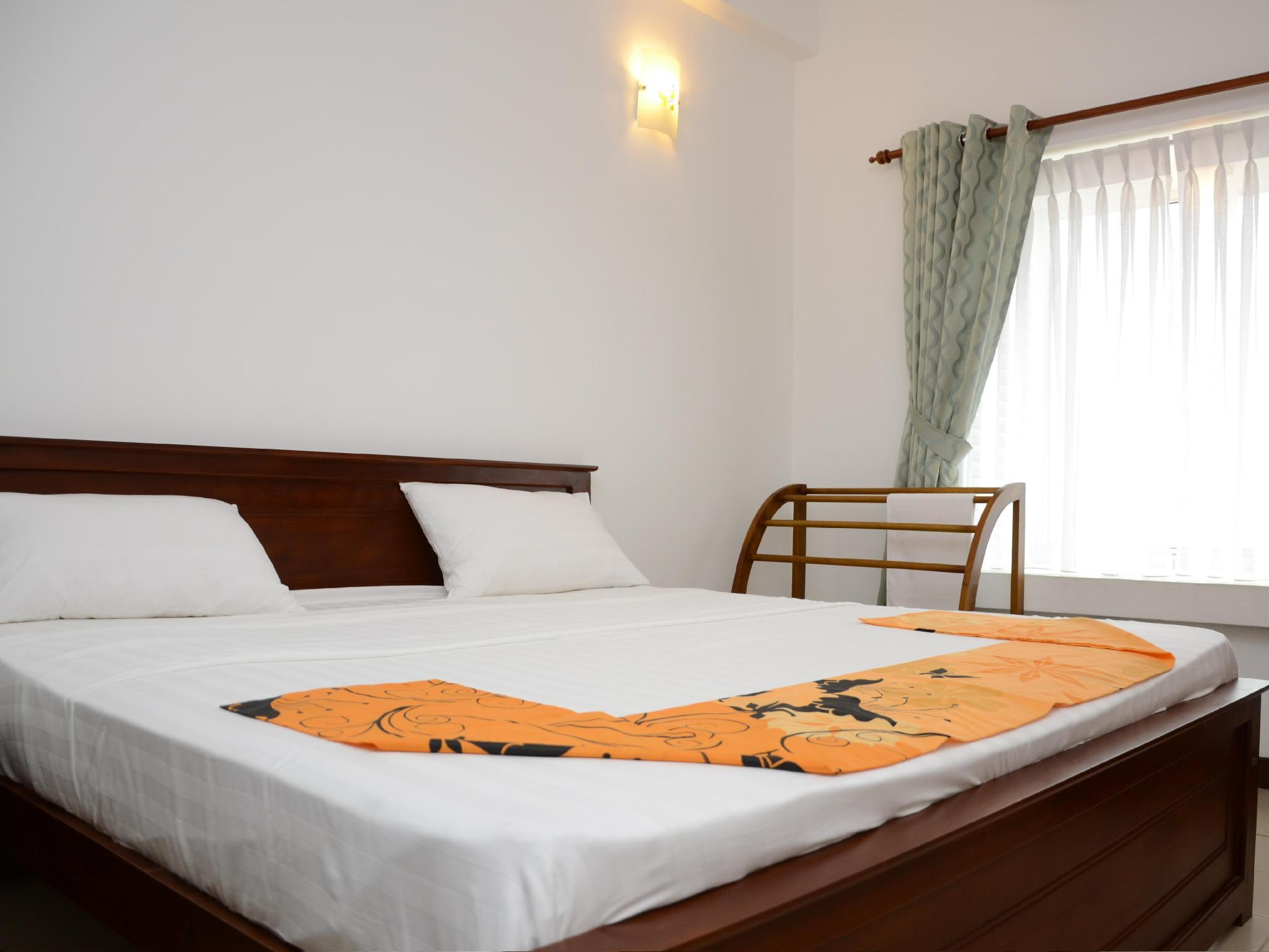 Kamar Deluxe Double dengan Pemandangan Laut (Deluxe Double Room with Sea View)