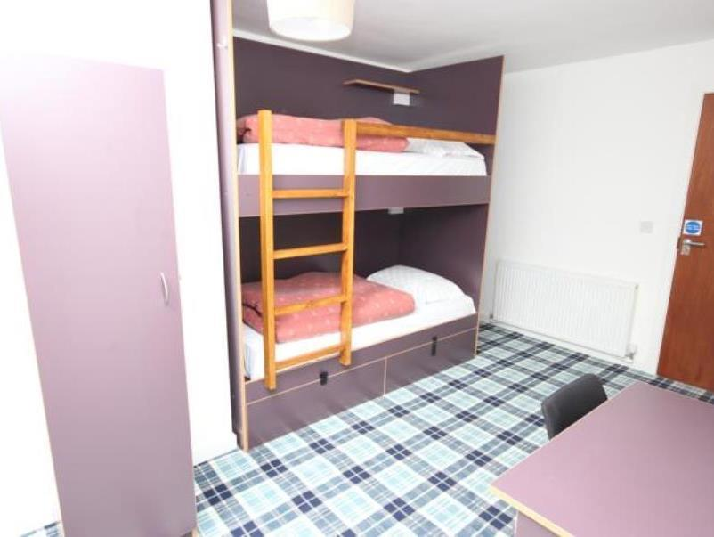 1 giường trong phòng Tập thể 3 giường (Bed in 3-Bed Dormitory Room)