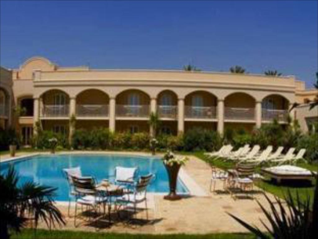 בריכת שחיה Romano Palace Luxury Hotel