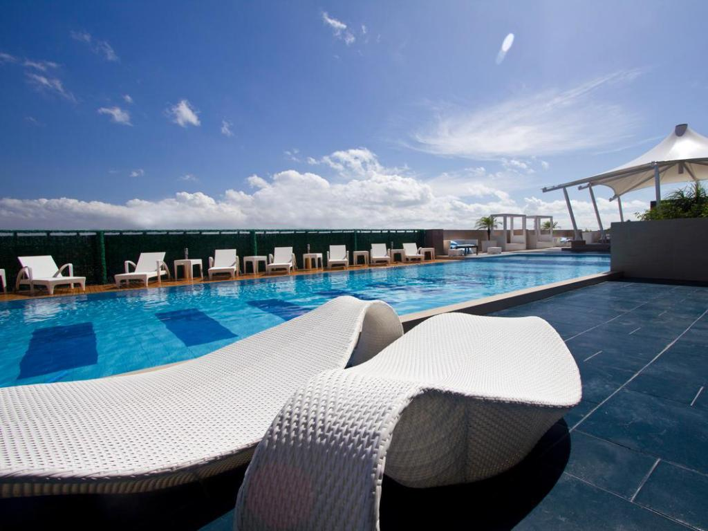 Best price on hotel the bellevue manila in manila philippines for Hotel with swimming pool in manila