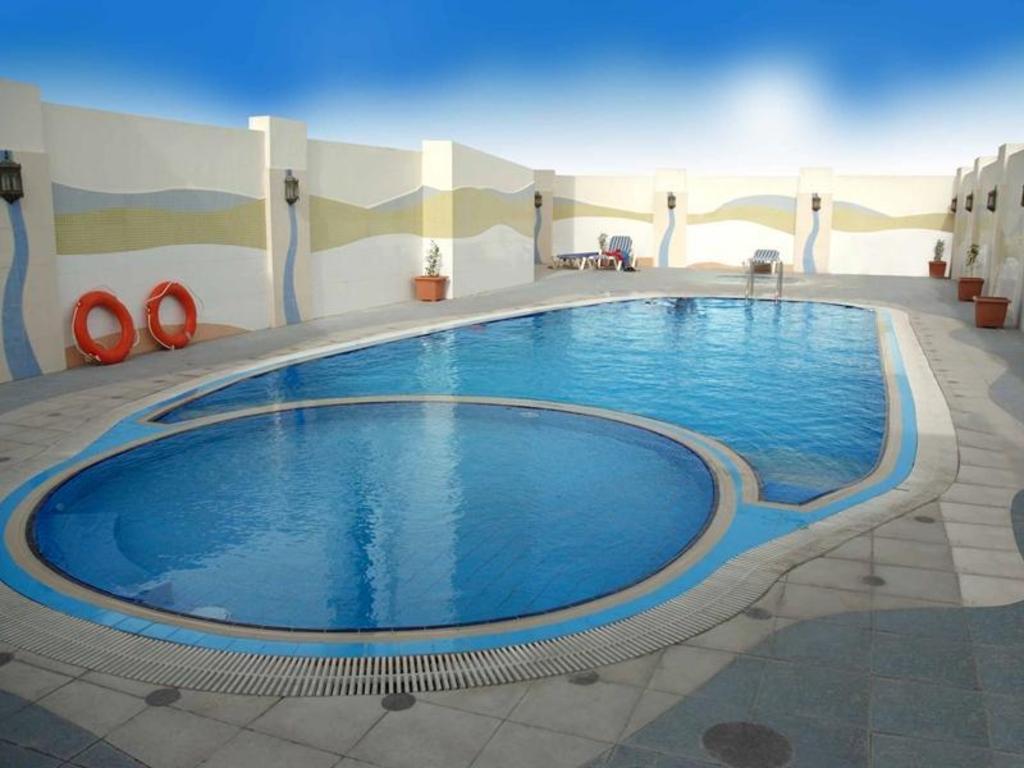 Best price on al jawhara gardens hotel in dubai reviews - Dubai airport swimming pool price ...