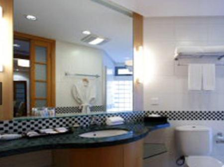 Bathroom ACME Riverside Serviced Apartment