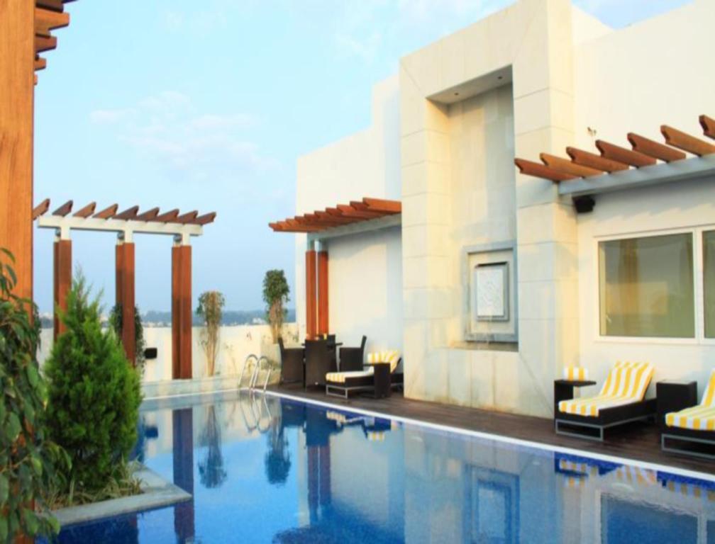 Lemon tree hotel gachibowli hyderabad india photos - Swimming pool construction cost in hyderabad ...