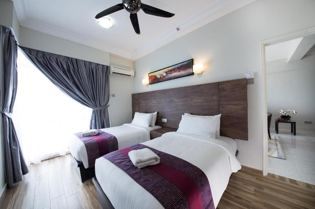 3-Bedroom Deluxe Apartment without Kitchen Facilities - Bed