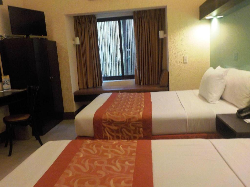 2 Queen Beds Room Microtel by Wyndham Boracay