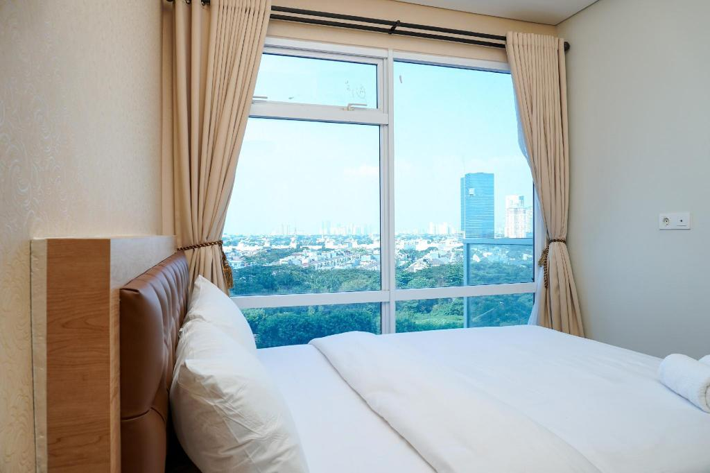 See all 15 photos Cozy 1BR at Puri Mansion Apartment By Travelio