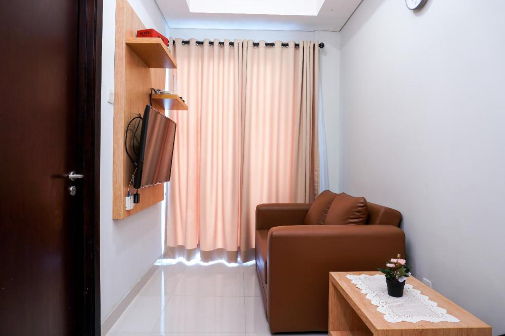 Cozy 1BR at Puri Mansion Apartment By Travelio